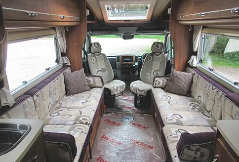 Auto-Sleeper Winchcombe 2014 Inside-View-Passenger-and-Drivers-Seat-Rotated-1